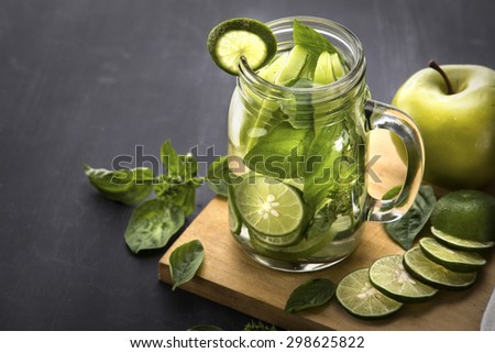 Summer fresh fruit Flavored infused water mix of Apple, lime and basil - stock photo
