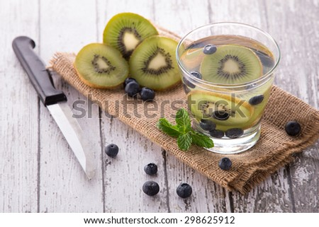 Summer fresh fruit Flavored infused water mix of Kiwi and blueberry - stock photo