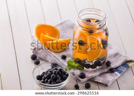 Summer fresh fruit Flavored infused water mix of orange, blueberry and mint - stock photo