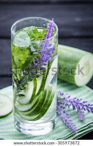 Summer fresh fruit Flavored infused water of cucumber and mint leaf - stock photo