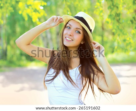 Summer fresh portrait of smiling young girl in hat outdoors, sunny day - stock photo