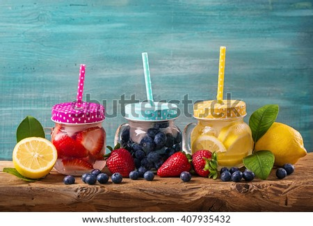 Summer fruit drinks on a wooden table - stock photo