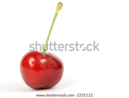Summer fruit salad ingredient, healthy red cherry on green stalk, macro close up with copy space
