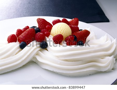Summer fruit with whipped cream - stock photo
