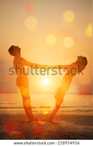 Summer fun holiday on beach background. A loving young couple hugging and kissing on the beach at sunset. Two lovers, man and woman near the water. Summer  scene in love  sunset sky - stock photo