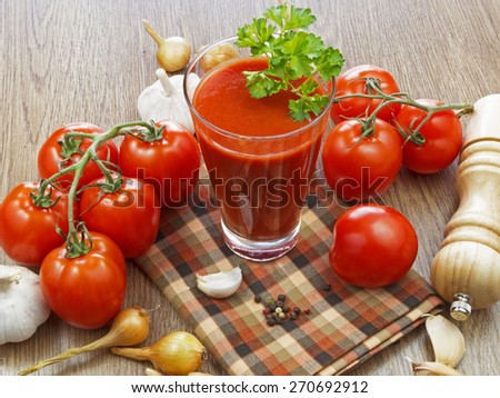 summer gazpacho soup with vegetables on wooden table - stock photo