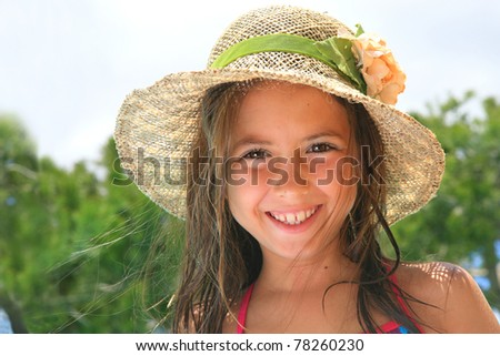 Summer girl - happy 9 years old girl on summer vacation - stock photo