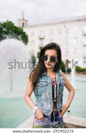 Summer girl in the glasses near water