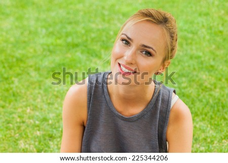 Summer girl portrait. Caucasian blonde woman smiling happy on sunny summer or spring day outside in park. - stock photo