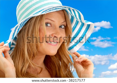 Summer girl portrait with a hat smiling outdoors