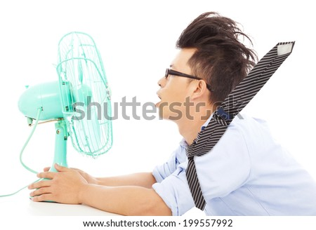 Summer heat, business man use fans to cool down - stock photo