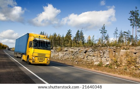 summer highway Scandinavia, trucks, rocks