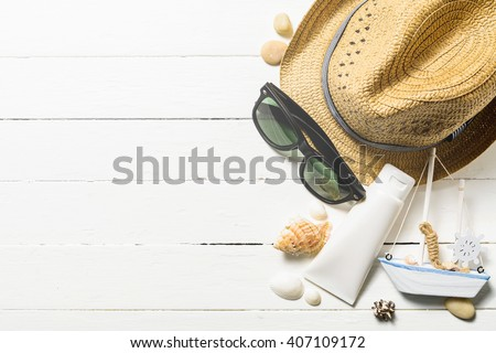 Summer holiday background, Beach accessories on white wood table, Vacation and travel items - stock photo