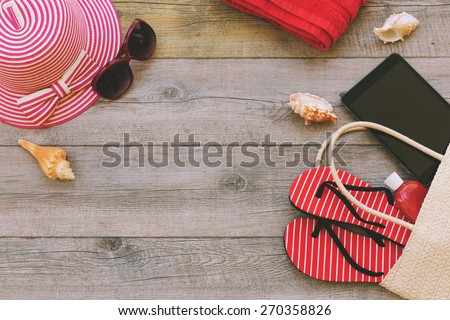 Summer holiday background with beach items and digital tablet. View from above - stock photo