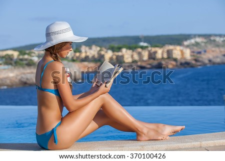 summer holiday in mallorca woman reading book - stock photo