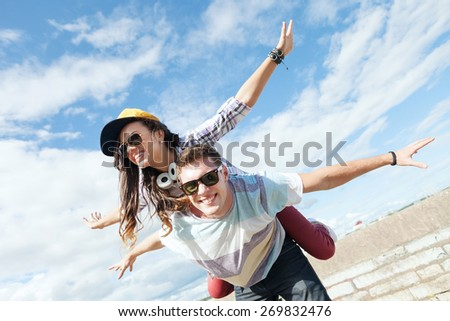 summer holidays and teenage concept - teenagers having fun outside - stock photo