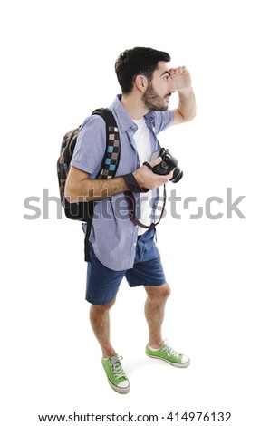 Summer holidays and tourism concept. Handsome man with backpack and camera. Isolated on white background - stock photo