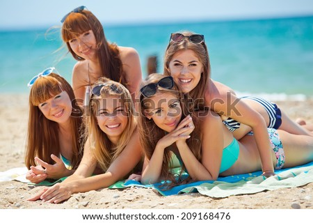summer holidays and vacation concept - smiling girls