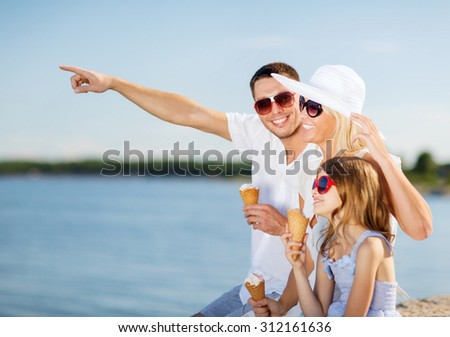 summer holidays, celebration, children and people concept - happy family eating ice cream