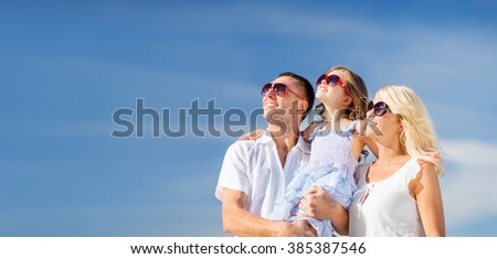 summer holidays, children and people concept - happy family with blue sky