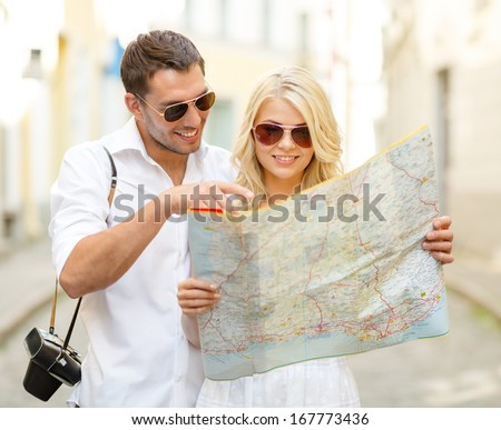summer holidays, dating and tourism concept - smiling couple in sunglasses with map in the city - stock photo