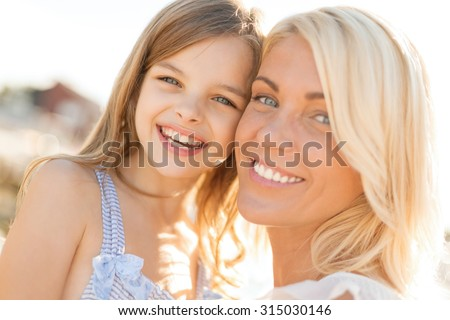 summer holidays, family, children and people concept - happy mother and child girl outdoors - stock photo