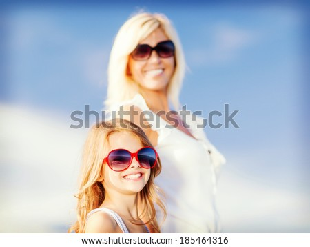 summer holidays, family, children and people concept - mother and child in sunglasses