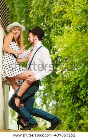 Summer holidays love relationship and dating concept - romantic playful couple retro style flirting outdoor - stock photo