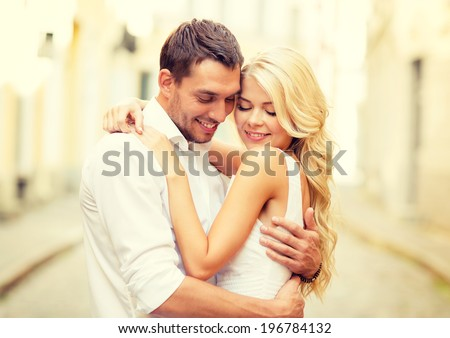 summer holidays, love, travel, tourism, relationship and dating concept - romantic happy couple hugging in the street - stock photo