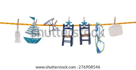 Summer holidays on the ocean. Isolated blue objects with a sail boat and luggage hanging on a clothing line. - stock photo