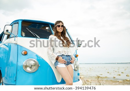summer holidays, road trip, vacation, travel and people concept - smiling young hippie women with minivan car - stock photo