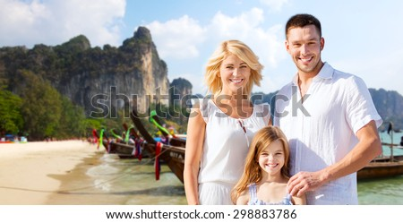 summer holidays, travel, tourism, children and people concept - happy family over beach in thailand or bali background - stock photo