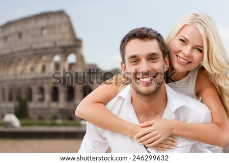 summer holidays, travel, tourism, people and dating concept - happy couple hugging over coliseum background - stock photo