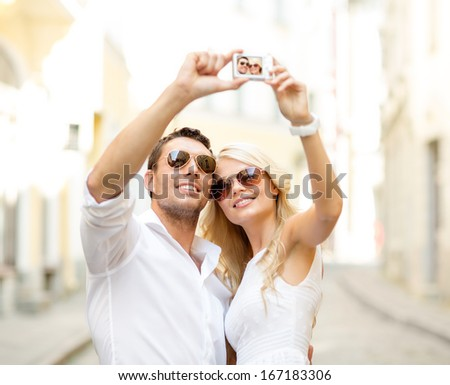 summer holidays, travel, vacation, tourism and dating concept - traveling couple taking selfie with camera - stock photo