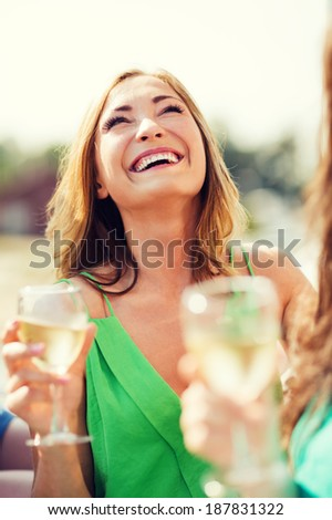 summer holidays, vacation and celebration - girl with champagne glass - stock photo
