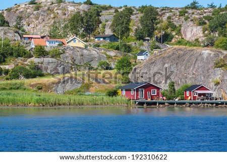 Summer house at the shore - stock photo