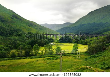 Summer in the Scotland highlands with stone bridge - stock photo