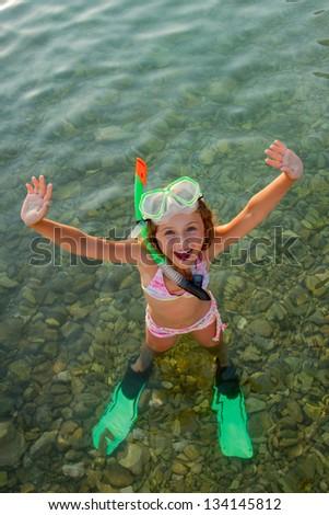 Summer joy, beach - lovely girl diver in the sea - stock photo