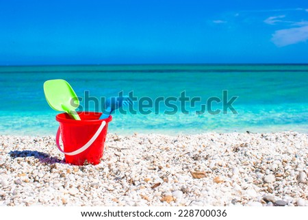 Summer kid's beach toys in the white sand - stock photo
