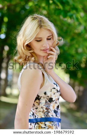 summer lady in the green park - stock photo