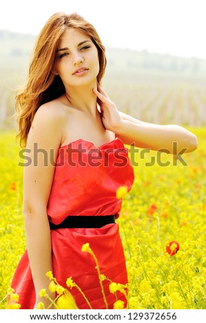 summer lady standing in the field - stock photo