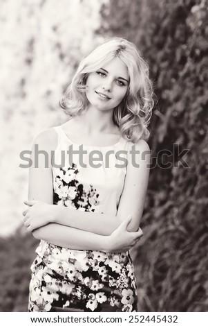 summer lady wearing dress near green wall - stock photo