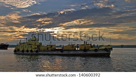 summer landscape barge on the River Cama at sunset