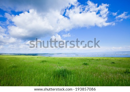 summer landscape beautiful clouds in the blue sky over a broad river on a sunny day - stock photo