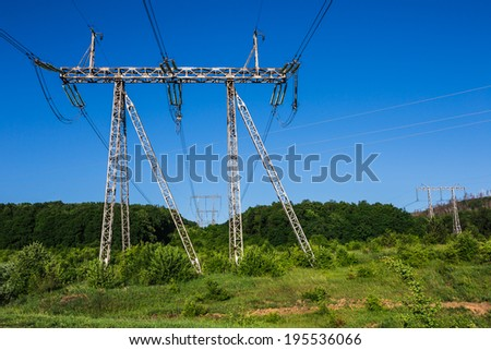 summer landscape close-up Front power lines in a green field  - stock photo