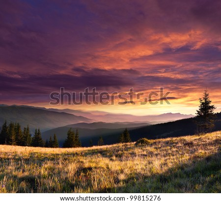Summer landscape in the mountains with dramatic sky. - stock photo