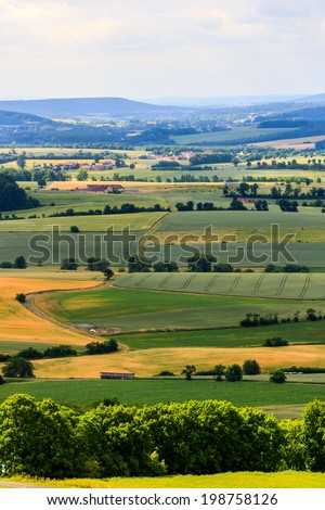 Summer Landscape in Upper Franconia, Germany, shot on a warm sunny day in June. Cloudy Sky in the rural countryside