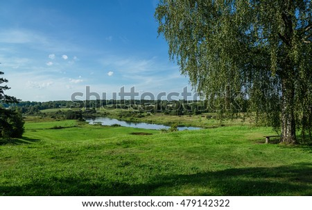 summer landscape of green hills on the background of the river
