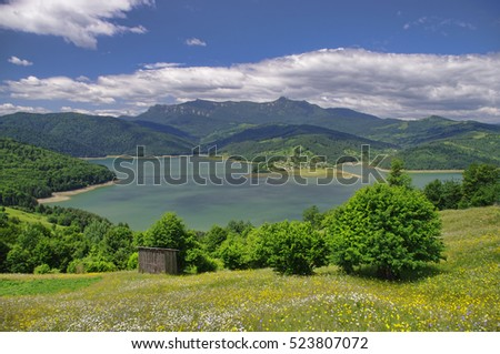 summer landscape of lake and mountain in Romania
