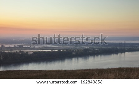 summer landscape of sunrise over the river early in the morning, the view from the mountain - stock photo